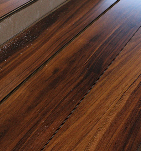 Traditional hardwood floors are made from solid wood planks with a stained and finished top. Solid hardwood floors are a proven value that provides an ageless look.